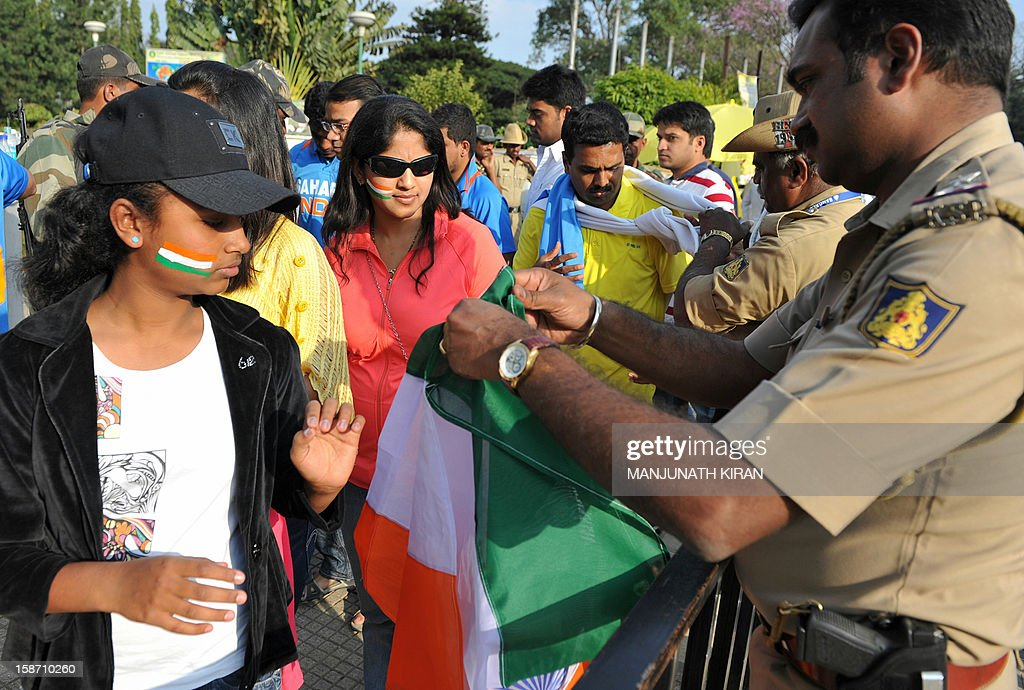 Cricket fans undergo security checks before entering The M. Chinnaswamy Stadium in Bangalore on December 25, 2012. Police were out in full force in the southern Indian city as part of a massive security operation ahead of Pakistan's first cricket tour of India for five years. AFP PHOTO/Manjunath KIRAN