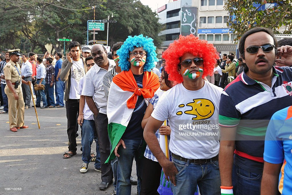 Cricket fans wait in line to enter The M. Chinnaswamy Stadium in Bangalore on December 25, 2012. Police were out in full force in the southern Indian city as part of a massive security operation ahead of Pakistan's first cricket tour of India for five years. AFP PHOTO/Manjunath KIRAN