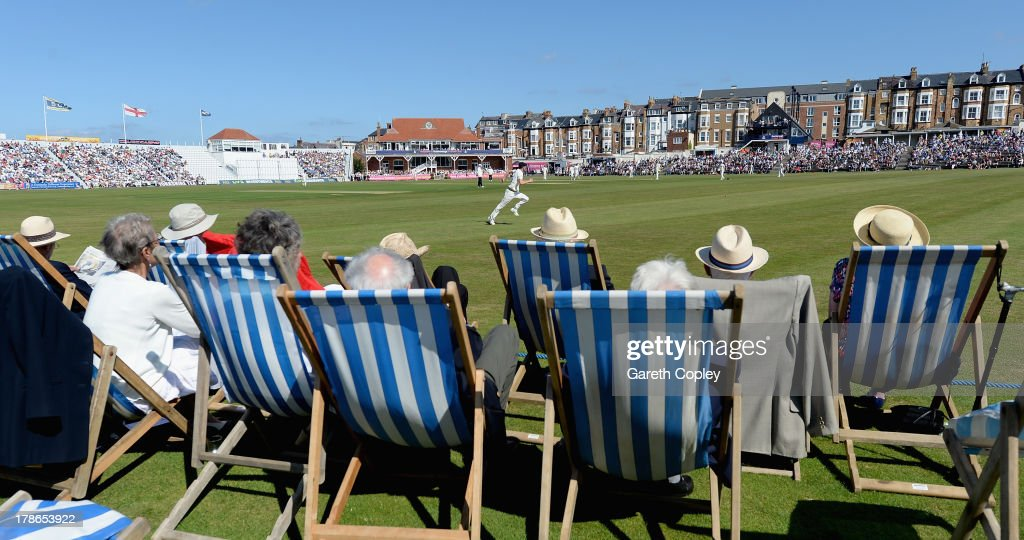 Cricket fans watch from deckchairs during the LV County Championship division one match at North Marine Road on August 30 2013 in Scarborough England