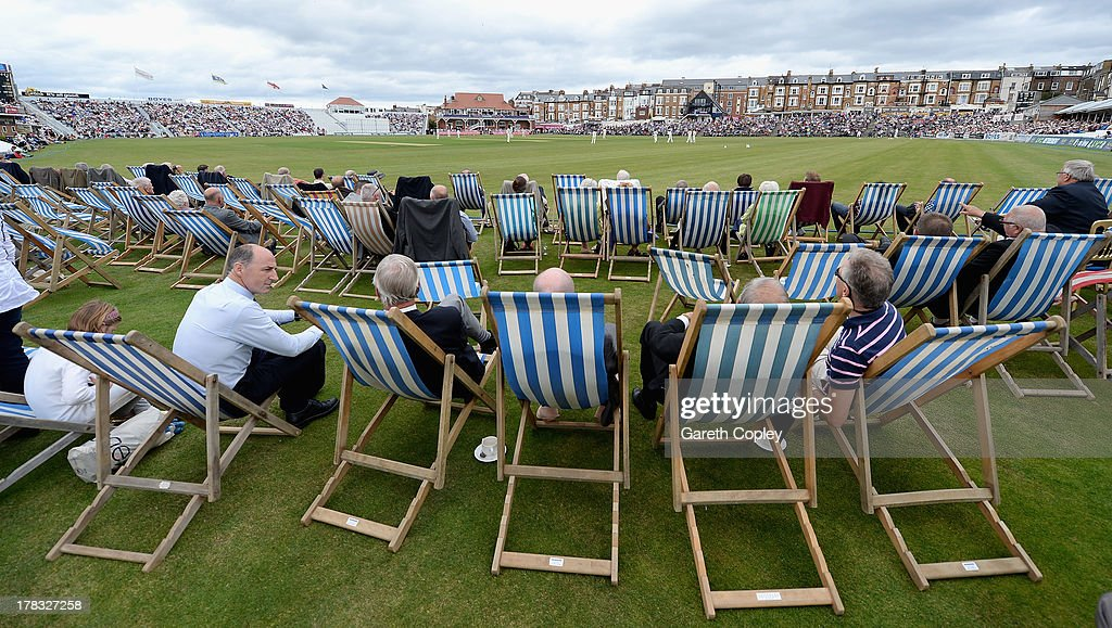 Cricket fans watch from their deckchairs during the LV County Championship division one match between Yorkshire and Durham at North Marine Road on August 29, 2013 in Scarborough, England.