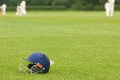 Cricket helmet on a cricket ground