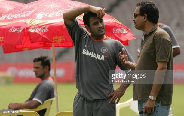 Cricket India vs South Africa India's Selection Committee Dilip Vengsarkar and MS Dhoni chats during India's net practice session prior to their...