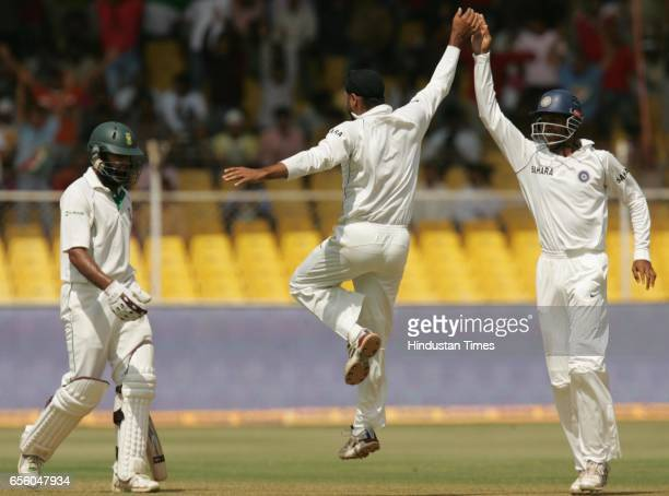 Cricket India vs South Africa Second Test Match at Ahmedabad India bowler Harbhajan Singh celebrates with Wasim Jaffer the wicket of South Africa's...