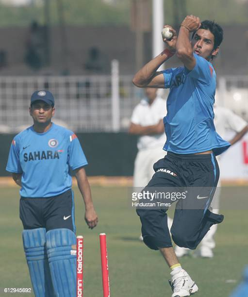 Cricket India vs Sri Lanka ODI India bowler Sudeep Tyagi bowls as Sachin Tendulkar watches during the net practice ahead of the first ODI between...