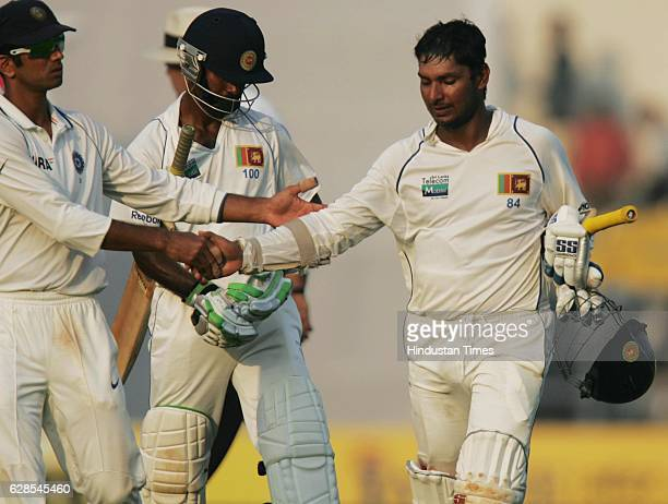 Cricket India vs Sri Lanka Test Series India's Rahul Dravid greets Sri Lanka batsman Sangakkara for his century during the fourth day of the third...
