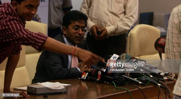 Cricket Indian Premier League IPL head Lalit Modi waits for the cameramen to set their cameras before announcing the list of players aquired by...