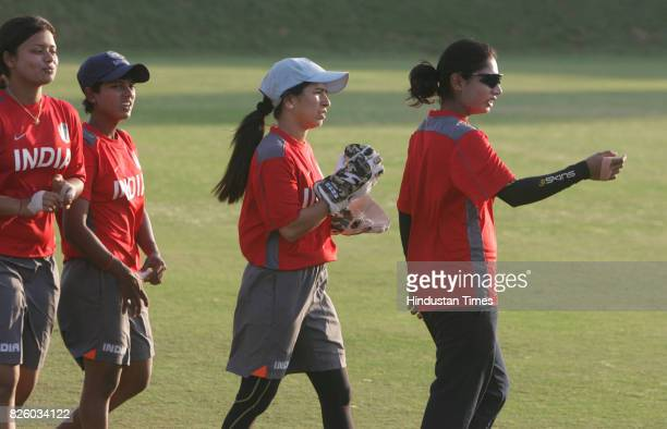 Cricket Indian Women Cricket Team Mithali Raj former captain of India Women cricket team practices with wicket keeper Sulakhsana Naik Poonam Raut and...