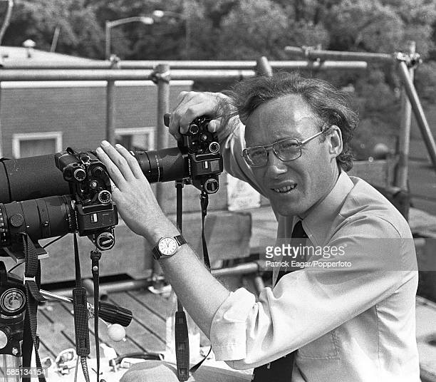 Cricket photographer Patrick Eagar on the roof of the pavilion at Edgbaston working with two Nikon F2s a 400 mm Nikkor IFED and a 600mm ED during the...