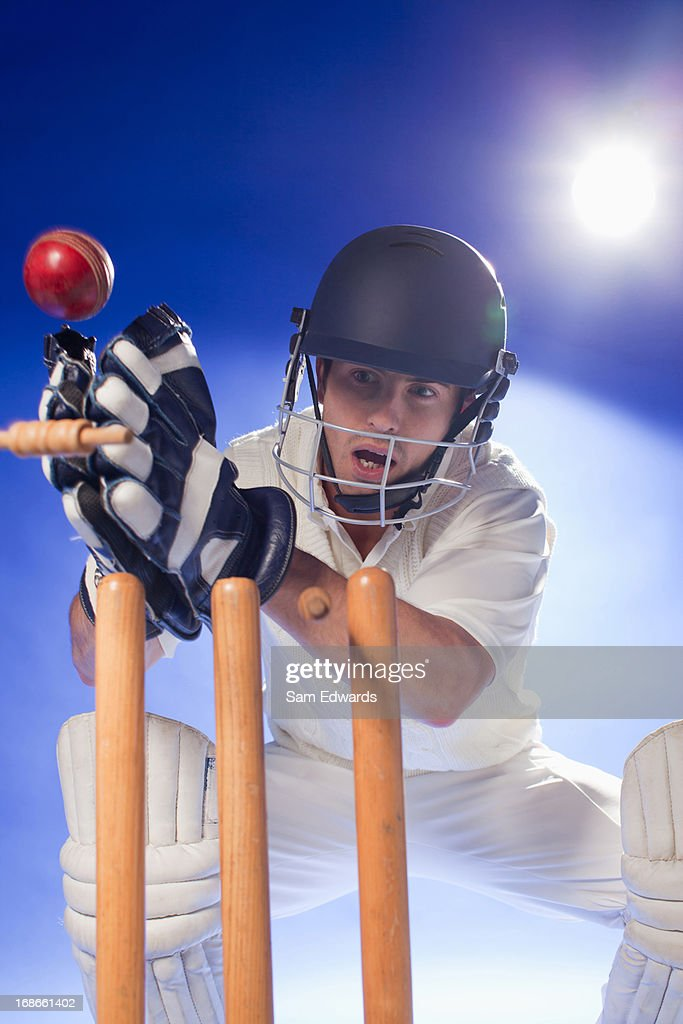 Cricket player lunging for bats