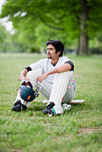 Cricket player sitting in field