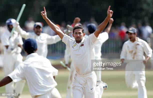 Cricket Ranji Trophy Final Match Mumbai fast bowler Ajit Agarkar Celebrates the wining movement after taking the last wicket of Karnataka's S Arvind...