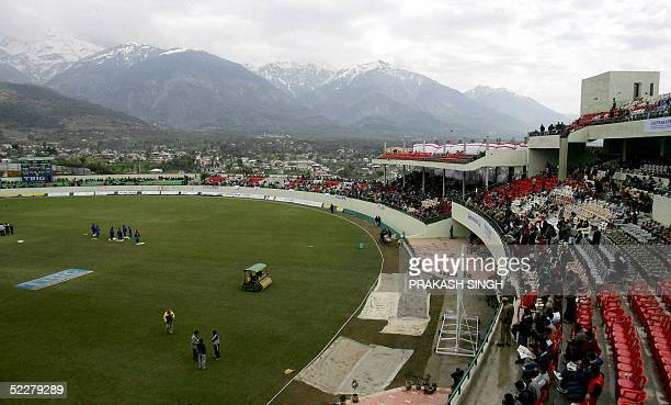 Cricket spectators wait for play to start on the final day of a three day match between Pakistan and an Indian Board President's XI at The Himachal...