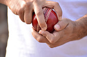 Close-up of cricket spin bowler grip