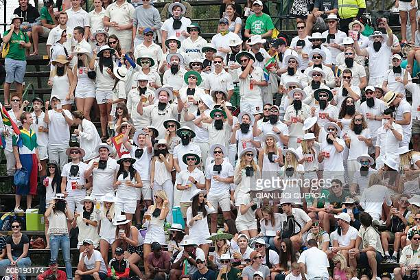 Cricket supporters all sporting a Hashim Amla mock beard cheer during day 3 of the third Test match between England and South Africa at Wanderers...
