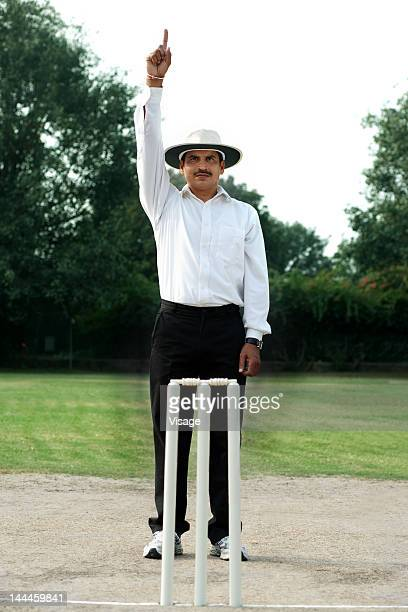Cricket umpire signaling out