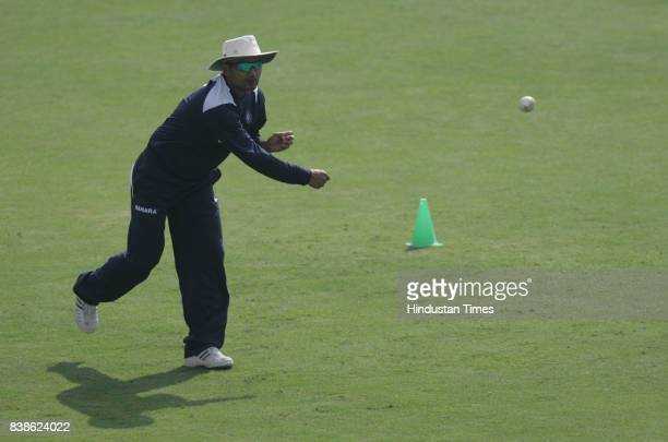 Cricket Virender Sehwag throws the ball during Indian Cricket team net practice session at Indore on Sunday Morning