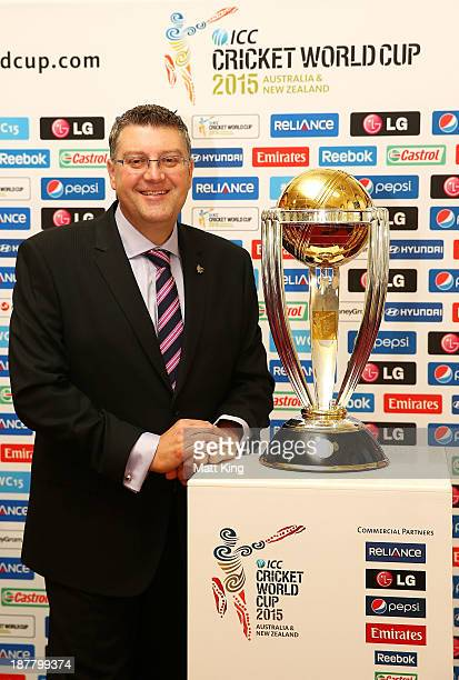 Cricket World Cup CEO John Harnden poses alongside the World Cup trophy during the ICC Cricket World Cup 2015 Ticket pricing announcement at the...