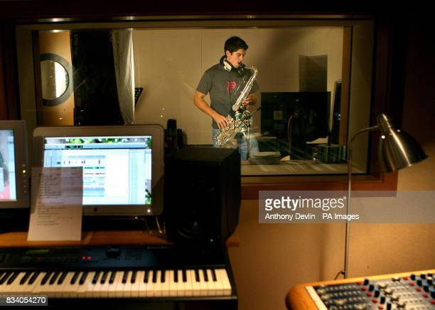Cricketer Alastair Cook poses with his Saxophone to promote the BBC childrens television show Freefonix at Lansdowne House studios Nottinghill London