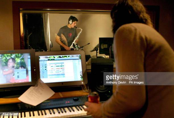 Cricketer Alistair Cook poses with his Saxophone to promote the BBC children's television show Freefonix at Lansdowne House studios Nottinghill London