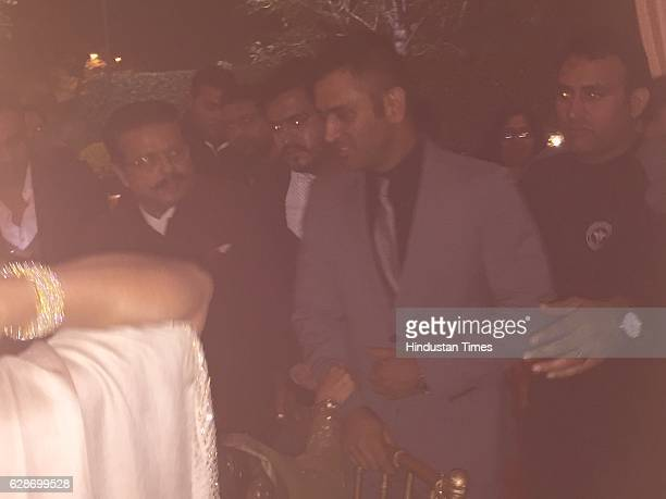 Cricketer MS Dhoni during the wedding reception of Indian Cricketer Yuvraj Singh and Bollywood actor Hazel Keech at ITC Maurya on December 7 2016 in...