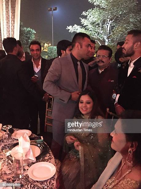 Cricketer MS Dhoni with his wife Sakshi Dhoni during the wedding reception of Indian Cricketer Yuvraj Singh and Bollywood actor Hazel Keech at ITC...