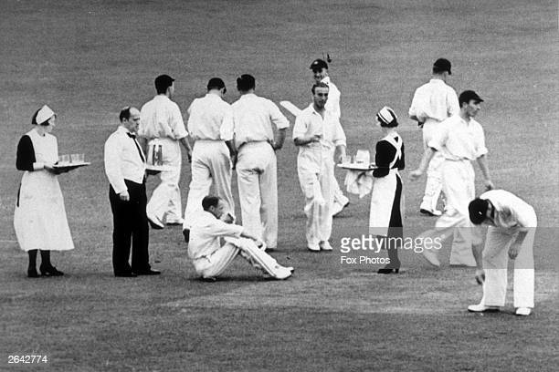 Cricketer Don Bradman and his team mates taking a break for tea on the second day of the fourth test match between England and Australia at Leeds Sir...
