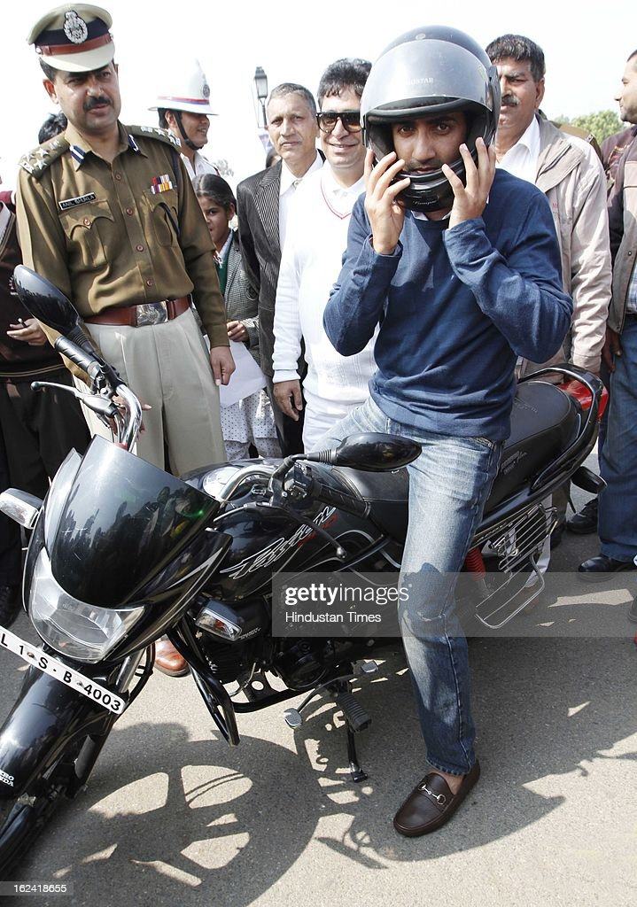 Cricketer Gautam Gambhir on bike for road safety awareness program, organised by Delhi Traffic police during Delhi Police week at India Gate Lawn on February 22, 2013 in New Delhi, India.