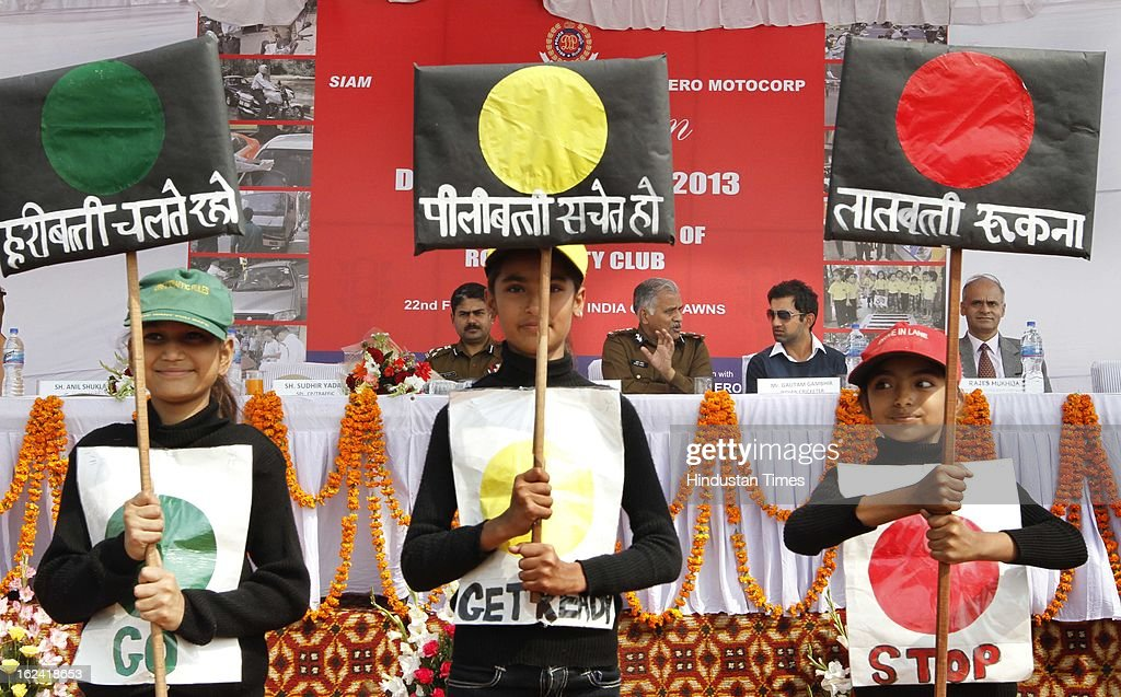 Cricketer Gautam Gambhir with Sudhir Yadav Spl CP of Delhi Traffic Police with school children who participated in spot painting competition organised by Delhi Traffic police on road safety during Delhi Police week at India Gate Lawn on February 22, 2013 in New Delhi, India.