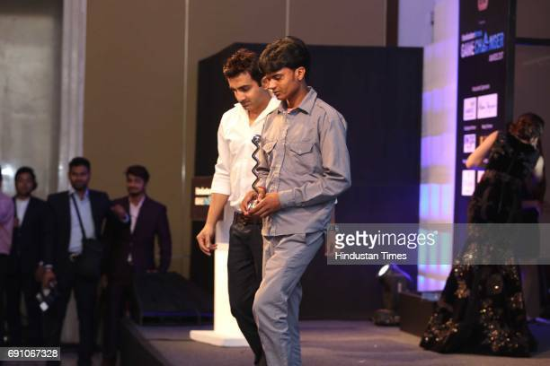 Cricketer Gautam Gambhir with Taxi driver and Game Changer Awardee Debendra Kapri during the Hindustan Times Game Changer Awards 2017 at Hotel Oberoi...