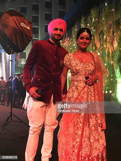 Cricketer Harbhajan Singh with his wife and actor Geeta Basra during the wedding reception of Indian Cricketer Yuvraj Singh and Bollywood actor Hazel...