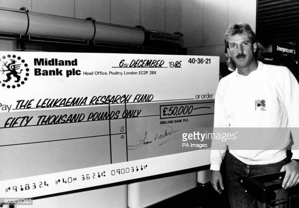 Cricketer Ian Botham on his way through Hearthrow Airport to catch a flight for Los Angeles stopping off 'en route' to accept a cheque from the...