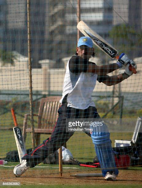 Cricketer Mahendra Singh Dhoni practices at Mumbai Cricket Association ground at Bandra