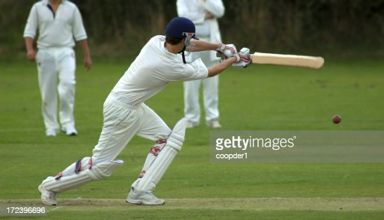 Cricketer playing cut shot
