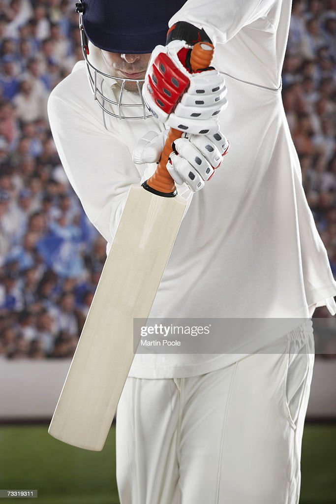Cricketer presenting  bat, ready to score, mid section : Stock Photo