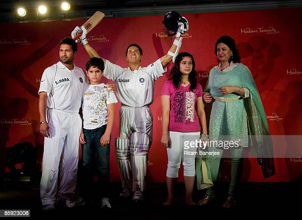 Cricketer Sachin Tendulkar poses with his son Arjun Sachin Tendulkar daughter Sara Sachin Tendulkar and wife Anjali Sachin Tendulkar beside his...
