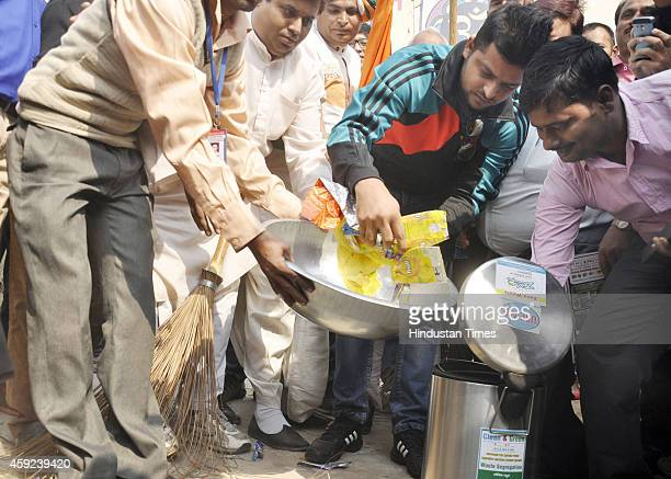 Cricketer Suresh Raina takes part in a cleanliness drive as part of Swachh Bharat Abhiyan at Kavi Nagar on November 19 2014 in Ghaziabad India