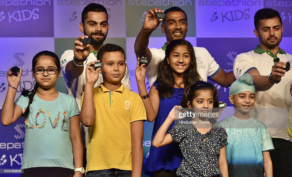 Cricketer Virat Kohili, Ravi Krishanan ( Co- founder Stepathlon Lifestyle), Amit Sajdeh (CEO, Cornerstone Sport& Entertainment) along with children, during the Launch of Stepathlon kids a company that shape future generation of India at Taj Place on June 28, 2016 in New Delhi, India.