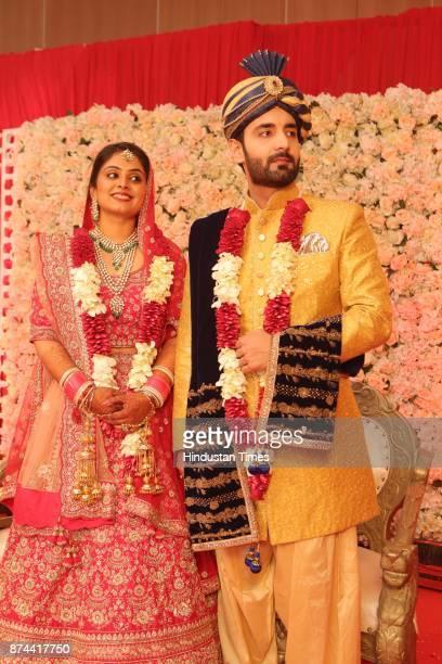 Cricketer Yashpal Sharma's daughter Preeti Sharma and Vaibhav Tyagi during their wedding reception party at The Leela Ambience Convention Hotel...