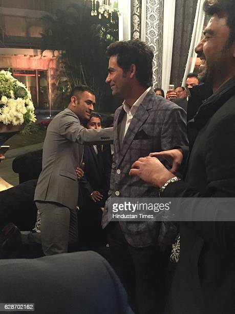 Cricketers MS Dhoni and Mohammad Kaif during the wedding reception of Indian Cricketer Yuvraj Singh and Bollywood actor Hazel Keech at ITC Maurya on...