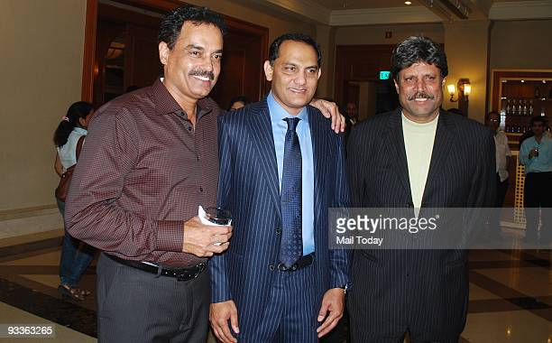Cricketers Dilip Vengsarkar Mohammed Azharuddin and Kapil Dev at a party to celebrate former cricketer Azharuddin's success in politics in Mumbai on...