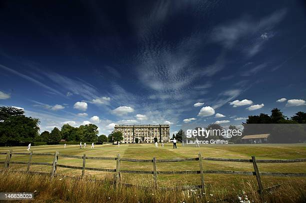 Cricketers from Stoneleigh Cricket Club play in the stunning grounds of Stoneleigh Abbey on July 17 2005 in Stoneleigh England