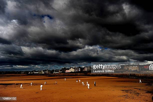 Cricketers from the Ship Inn Cricket Club play on the beach on August 29 2010 in the Town of Elie Fife Scotland This Image is taken from the book...