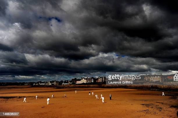 Cricketers from the Ship Inn Cricket Club play on the beach on August 29 2010 in Elie Scotland