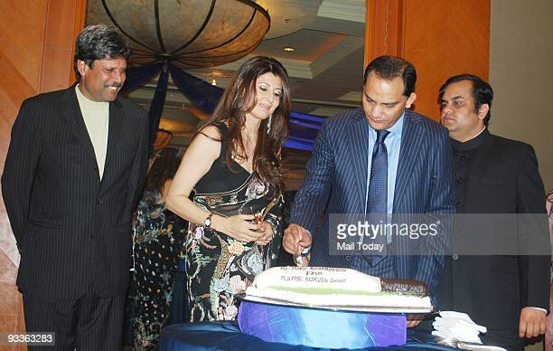 Cricketers Kapil Dev and Mohammed Azharuddin with wife Sangeeta Bijlani at a party to celebrate Azharuddin's success in politics in Mumbai on Sunday...