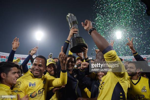 Cricketers of Peshawar Zalmi their victory over Quetta Gladiators in the final cricket match of the Pakistan Super League at The Gaddafi Cricket...