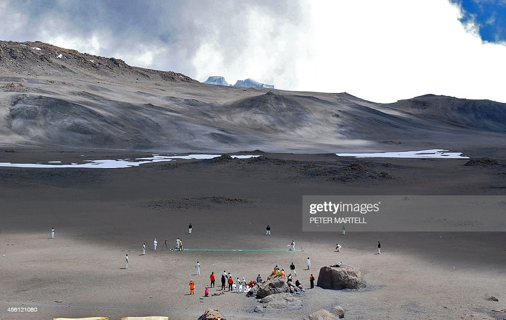 Cricketers play on September 26 2014 on the icecovered crater of the Kilimanjaro mountain Tanzania The game is an attempt to play the world's highest...