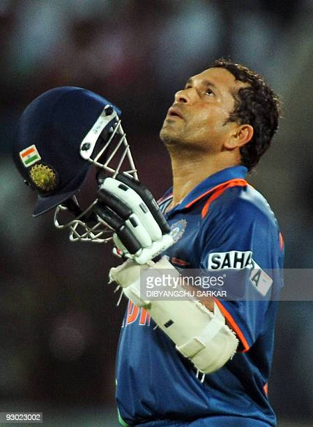 CricketINDTendulkar FOCUS In this file photograph taken on November 5 Indian cricketer Sachin Tendulkar celebrates after scoring a century during the...