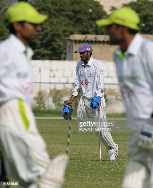 STORY 'CricketPAKdisabledFEATURE' by Shahid Hashmi In this picture taken on December 5 disabled Pakistani cricketer Akseer Abbasi walks with the aid...