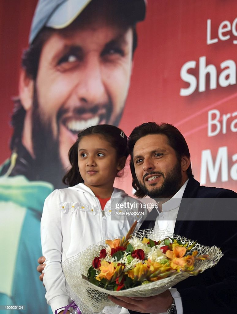 Cricket-Pakistan-Afridi' FOCUS by Shahid HASHMI This photograph taken on December 30, 2014, shows Pakistani al-rounder Shahid Afridi (R) posing as he ... - cricketpakistanafridi-focus-by-shahid-hashmi-this-photograph-taken-on-picture-id460926104