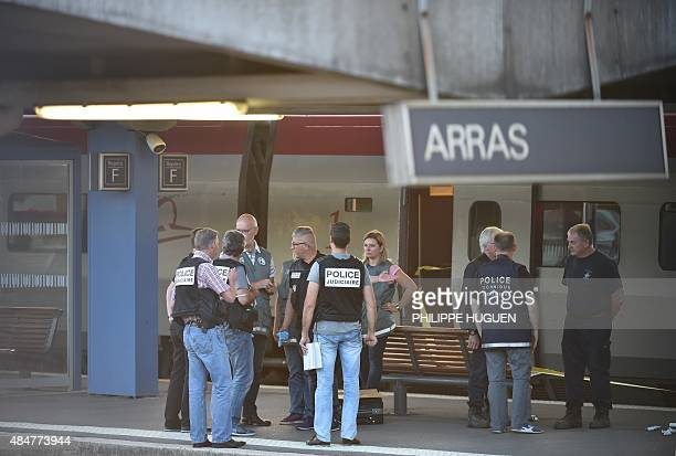 Crime and forensic investigators stand on a platform next to a Thalys train of French national railway operator SNCF at the main train station in...